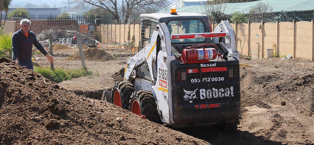 , Bobcat skidsteer helps Stepping Stone extension get off the ground